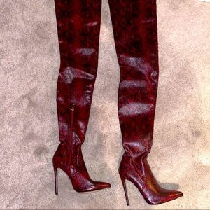 Red snakeskin thigh high boots